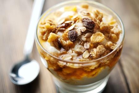 close up of greek yogurt with golden wild honey and musli