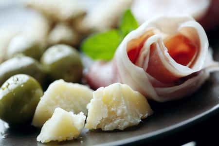 italian cuisine: plate of italian foods like parma ham and parmesan cheese