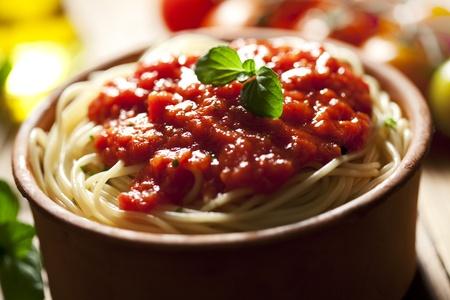 closeup of juicy pasta and tomato sauce