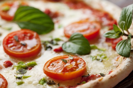 fresh italian pizza, with tomato, mozzarella and green pepper Stock Photo