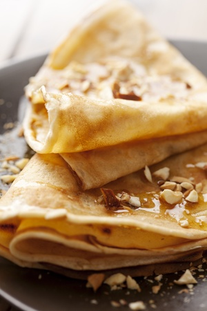 crepes with honey or sirup and roasted nuts