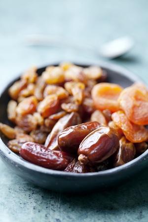 closeup of dried abricot, dades and raisins