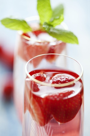 to refreshing strawberry champagne cocktails on a rustic garden table photo