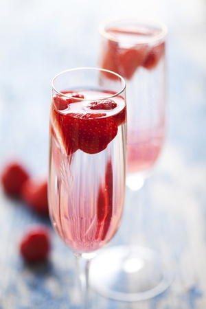 champagne flute: to refreshing strawberry champagne cocktails on a rustic garden table