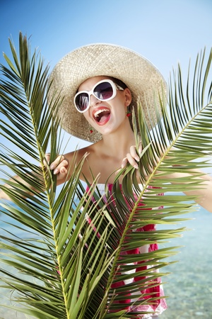 young female with palm leaves Stock Photo - 10551736