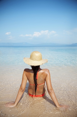 young female at the beach photo