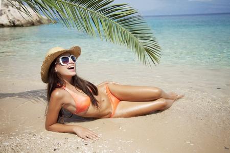 female in bikini enjoying the sun Stock Photo