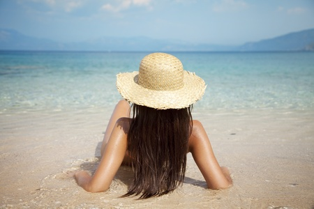 exotism: young attractive female sunbathing Stock Photo