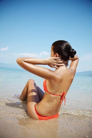 beach wear: female in bikini enjoying the sun Stock Photo