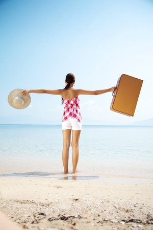 holiday maker: happy holiday maker arrives at destination