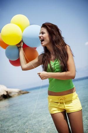 young female ith colorful balloons photo
