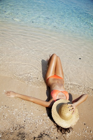 young attractive woman enjoying the beach