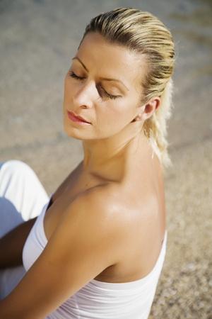 woman  meditating in the morning sun photo