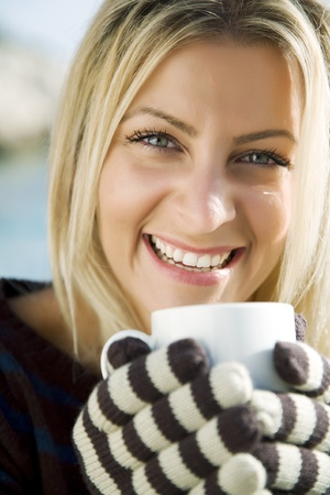 smiling woman with cup of hot-something Stock Photo - 10714705