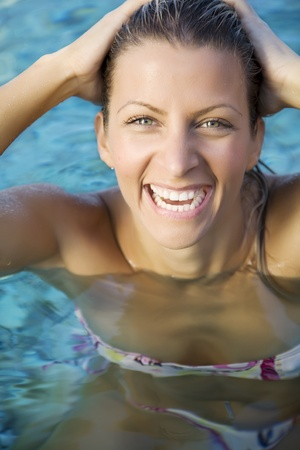 young female laughing in the sea Stock Photo - 10714691
