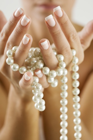 female hands with pearls