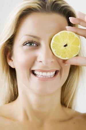 happy woman with slice of lemon Stock Photo