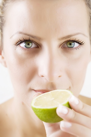 woman with half fresh lime, skin retouched Stock Photo - 10714693