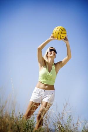 beautiful blond playing beach volley photo