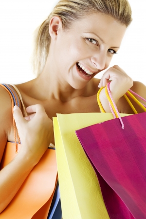 young pretty smiling woman with shopping bags photo