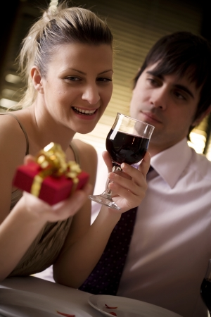 couple having a romantic dinner in restaurant, (or home) Stock Photo