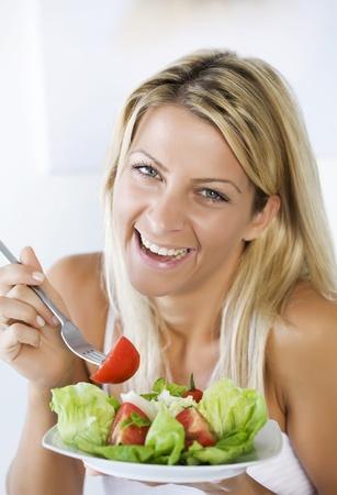 highkey: high-key portrait smiling female eating her salad