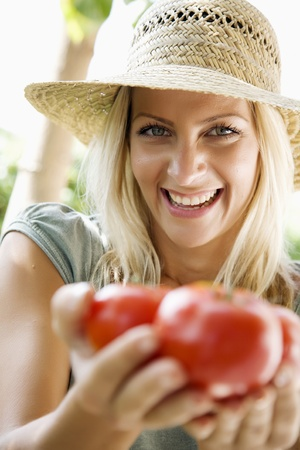 tomatos: focus on womans face Stock Photo