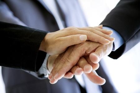 stacked hands, symbolising team-effort Stockfoto