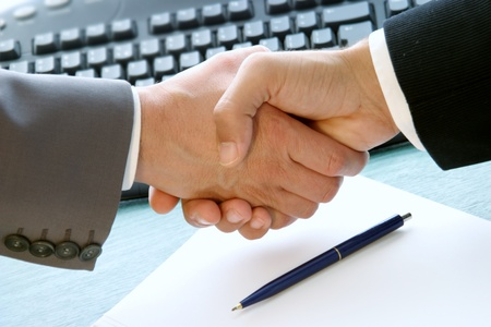 businessmen shaking hands: business handshake