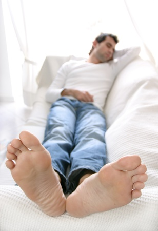 lying on couch: relaxation Stock Photo
