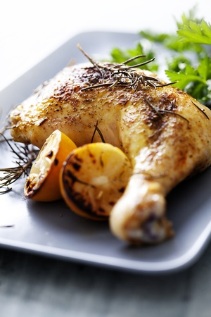 roast chicken: closeup of roast chicken and oven potatoes Stock Photo