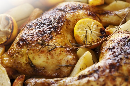 oven potatoes: closeup of roast chicken and oven potatoes Stock Photo