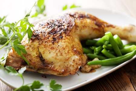 closeup of roast chicken and oven potatoes Archivio Fotografico