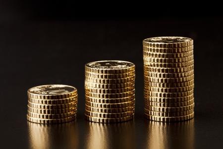 piles of golden coins  Standard-Bild