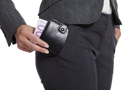 business woman putting a loaded wallet in her pocket Stock Photo - 12615455