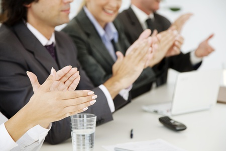 business people at a board meeting, clapping photo
