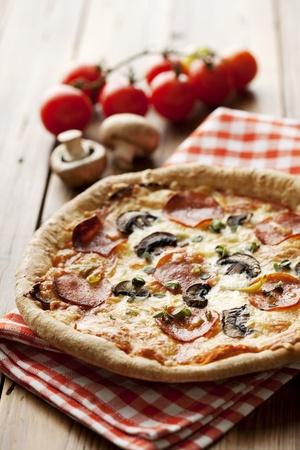 italian style pepperoni pizza whith mushrooms