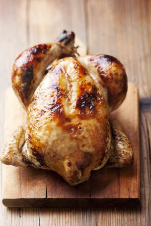 whole chicken: roast chicken on wood cutting board