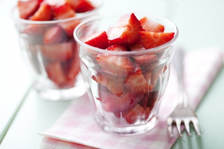 fresh strawberry pieces in a rustic glass Stock Photo - 13797131