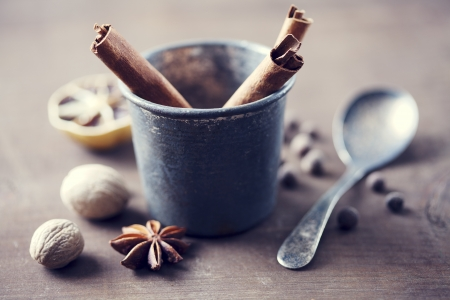cooking utensils: herbs and spices in a rustic setting Stock Photo