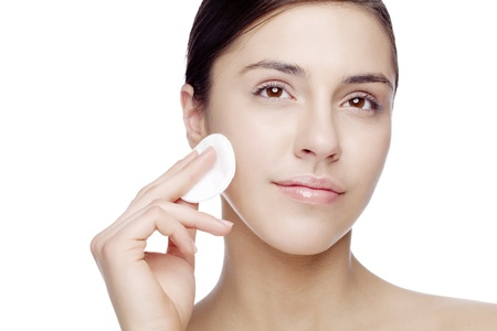 female with cotton, removing makeup or rinsing face Stock Photo