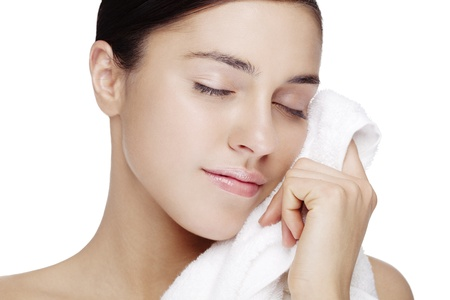 sfresh faced female with clean white towel  skin has been retouched to keep all texture