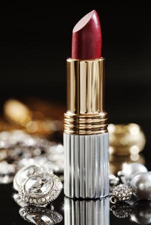 still life of jewelry  and high end lipstick Standard-Bild