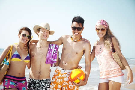 multi cultural: group of young people going to the beach