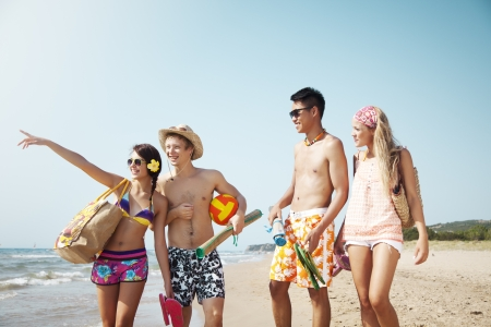group of young people going to the beach
