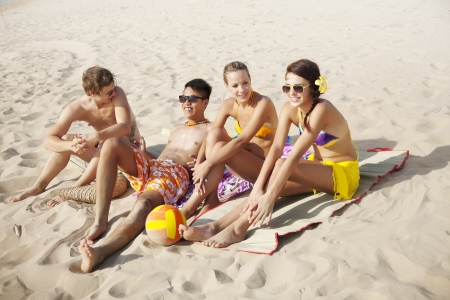 teenagers laughing: group of young people at the beach Stock Photo
