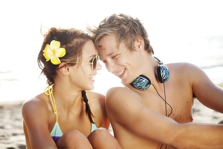 young couple having fun at the beach photo