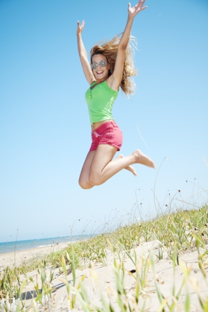 young woman jumping up in the air