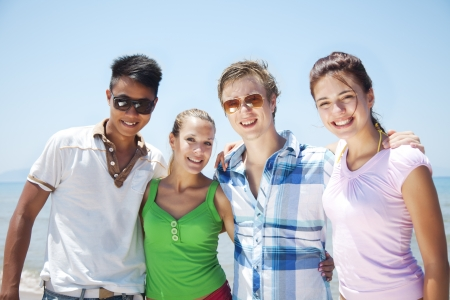 multi cultural: group of friends, looking at camera, smilingf  Stock Photo