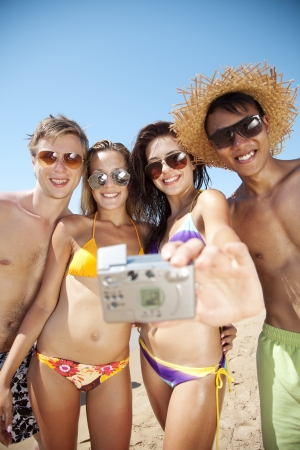group of young people taking a photograph